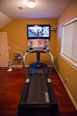 Exercise on the treadmill while watching TV or any of the integrated devices as shown here in this local area home